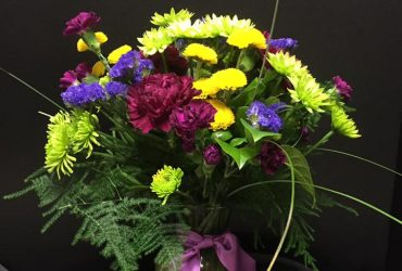 Purple carnations, yellow mums, blue statice Floral arrangement
