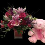 Floral Arrangement of Stargazer Lilies, pink roses and stuffed pink animal New Baby Girl Arrangement