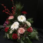Christmas Arrangement by Casa de Flores with with Gerbera Daisies, carnations, plaid ribbon