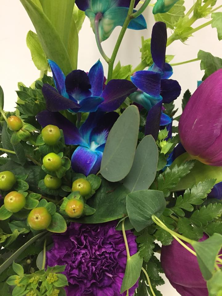 Blue orchids, purple tulips and carnations in this fresh floral arrangement by Casa de Flores