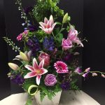 Stargazer Lilies, purple roses, pink gerbera daisies overflow in this beautiful large floral arrangement by Casa de Flores